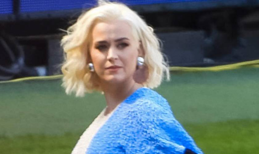Katy Perry Shows Off Growing Baby BumpIn Tight Dress Ahead Of PerformanceIn Australia